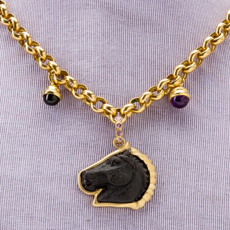 18 kt. hand carved black onyx horse head pendant with pink sapphire bail